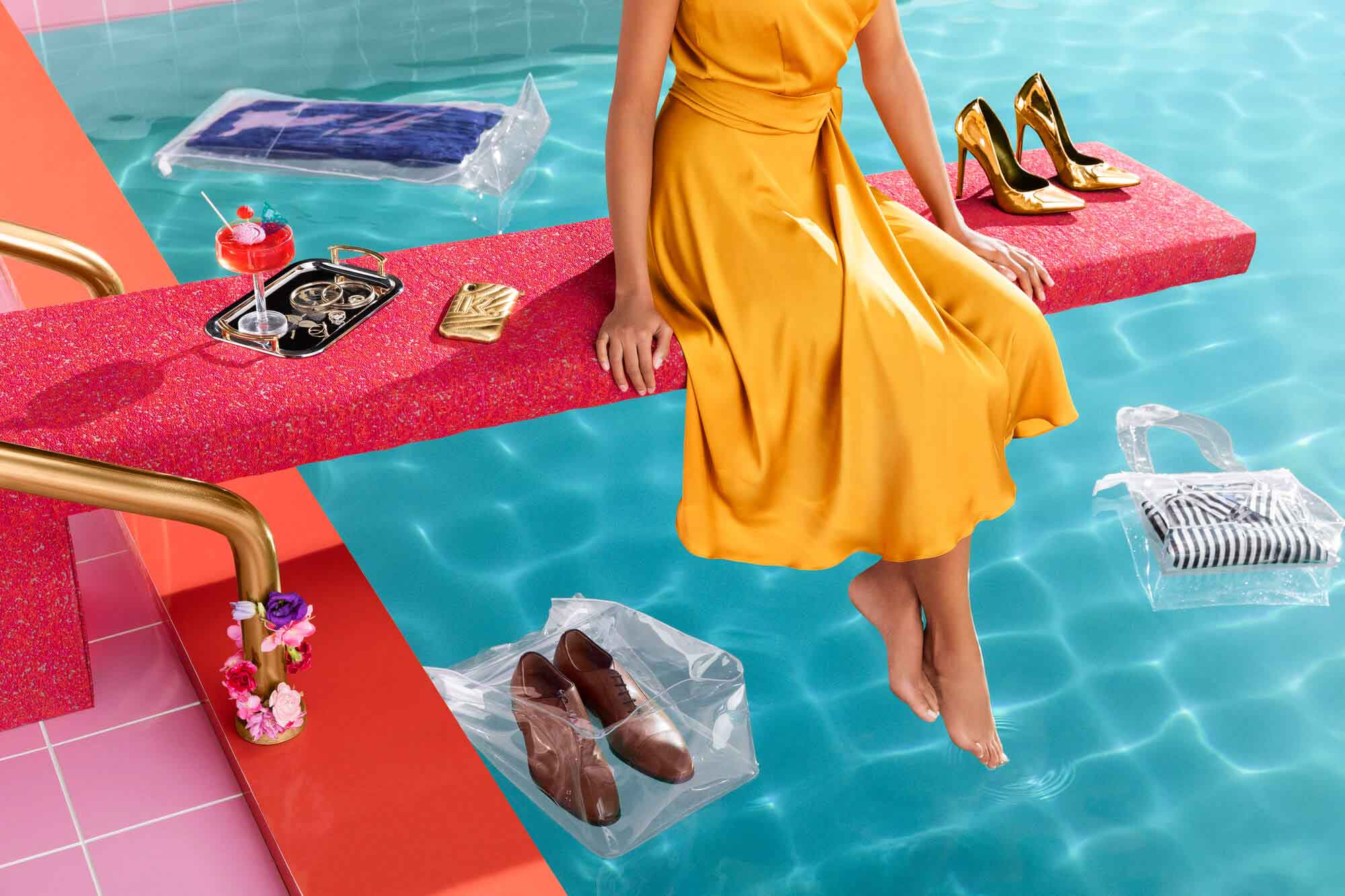 Woman sitting on a diving board surrounded by shoes