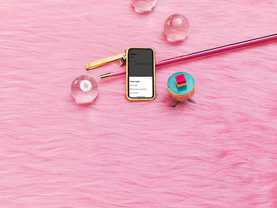 Klarna app shown on a mobile screen on a pink background