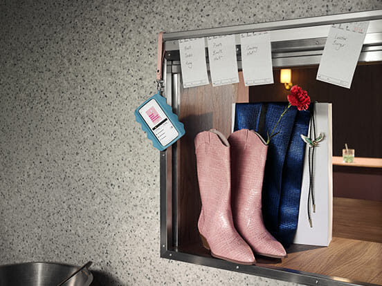 Pink cowboy boots with Klarna app on phone