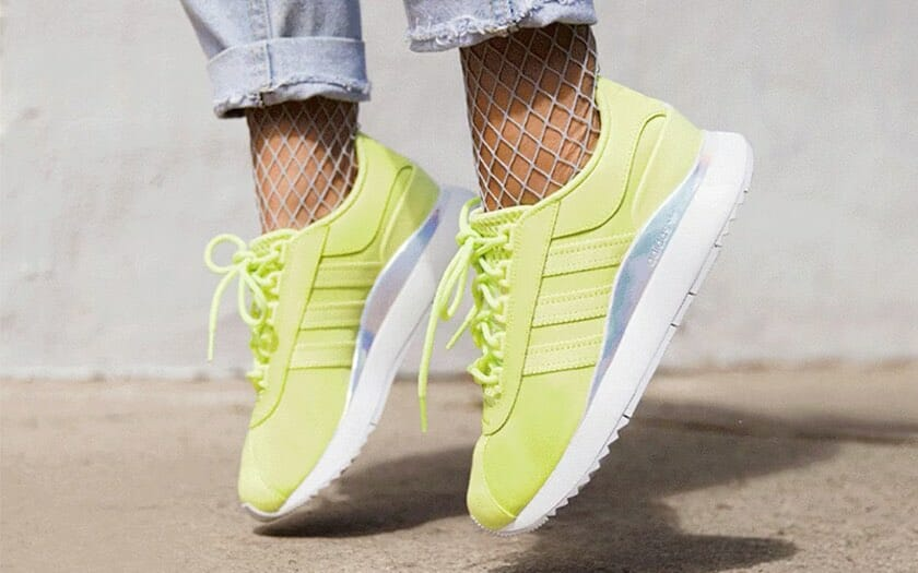 Neon yellow Adidas running shoes