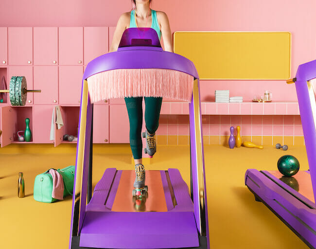 Woman running with roller skates on a purple treadmill